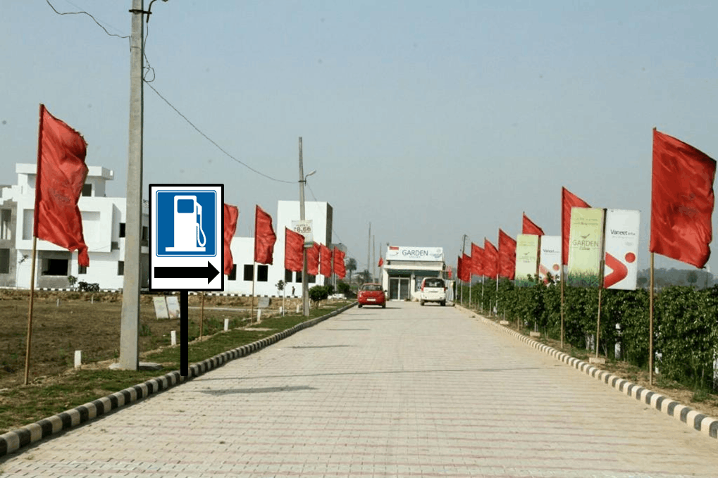 Picture shows straight road with traffic sign