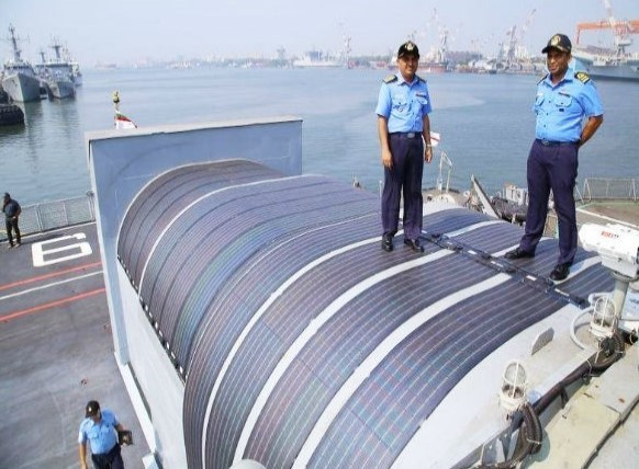 INS Sarvekshak, officer commander standing on solar panels