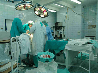Image why do Doctors wear green/blue dress inside operations theatre